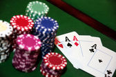 Four aces and a big pile of chips — Stock Photo
