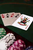 Four aces and joker in the pack — Stock Photo