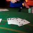 Poker player throwing in loosing hand of cards — Stock Photo