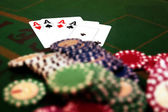Four aces and a pile of chips — Stock Photo