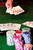 Poker player showing unbeatable royal flush — Stock Photo