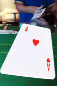 Poker player throwing hand of cards — Stock Photo