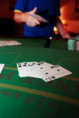 Poker player throwing in loosing hand of cards — Стоковое фото
