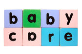 Baby care in toy play block letters with clipping path on white — Stock Photo