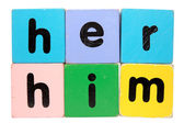 Her him in toy play block letters with clipping path — Stock Photo