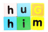 Hug him in toy play block letters with clipping path on white — Stock Photo