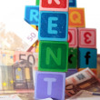 Rent money in toy blocks — Stock Photo