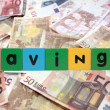 Stock Photo: Cash savings in toy letters