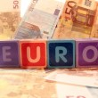 Euro in blocks on euro cash — Stock Photo