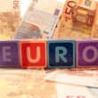 Euro in blocks on euro cash — Stock Photo #8537773