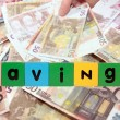 Euro note savings in toy letters - ストック写真