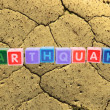 Earthquake in toy block letters — Stockfoto