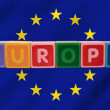Europe and flag in toy letters - Stock Photo
