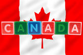 Canada and flag in toy block letters — Stock Photo