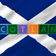 Scotland and flag in toy block letters — Stockfoto