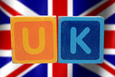 Uk and flag in toy letters — Stock Photo