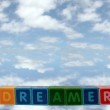 Little dreamers on blocks in clouds — Stock Photo