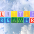 Little dreamers on toy blocks in clouds — Stock Photo #8614356