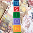 Foto Stock: Pensions in wooden block letters with euros