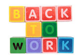 Back to work in toy block letters — Stock Photo