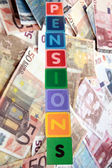 Pensions in wooden block letters with euros — Stock Photo