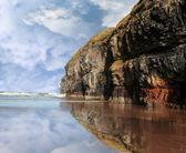 Cliff reflection on ballybunion beach — Stock Photo