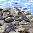 Rocks on the shoreline - Stockfoto