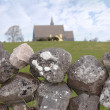 Ballyvaughan stone wall and church — Stock Photo #8970287