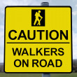 Caution walkers on road sign with clipping path — Stock Photo