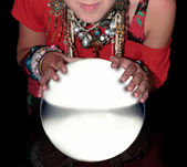 Fortune teller over a blank crystal ball — Stock Photo