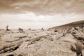 Sepia rocks in hilly rocky burren landscape — Stock Photo