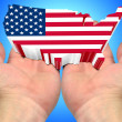 USA flag on the palms of the hands - Stock Photo