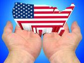 Flaga usa na dłoniach — Zdjęcie stockowe