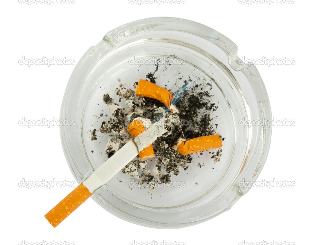 Cigarettes butts in ashtray isolated on white background — Stock Photo #8683668
