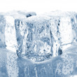 Stock Photo: Three melting ice cubes