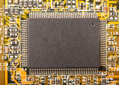 Electronic chip on circuit board — Stock Photo