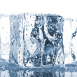 Three ice cubes with water drops — Stock Photo