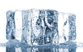 Three ice cubes with water drops — Stockfoto