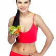 Portrait of a pretty young woman eating vegetable salad isolated on a white background — Stock Photo