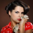 A photo of beautiful brunette is in style of pinup, glamour — Stock Photo