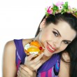 Young, beautiful brunette with fruit cake isolated on white - Stock Photo