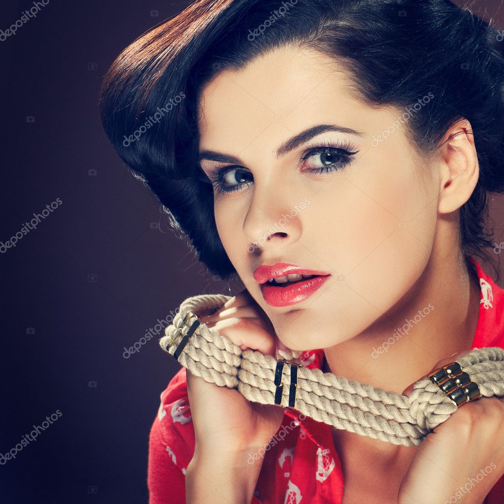 A photo of beautiful brunette is in style of pinup, glamour — Stock Photo #10218521