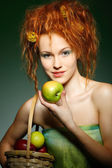 Portrait of beautiful sexual redheaded girl with apples — Stock Photo