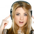 Beautiful girl with headphones isolated on a white background — 图库照片