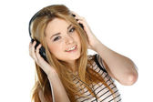 Beautiful girl with headphones isolated on a white background — Stock Photo