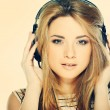 Beautiful girl with headphones isolated on a background - 图库照片