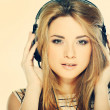 Beautiful girl with headphones isolated on a background - Stockfoto