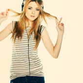 Beautiful girl with headphones isolated on a background — Stock Photo