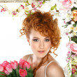 Beautiful redheaded girl with bouquet of tulips, which stands in gold frame, flowered, isolated on white background — Stock Photo #9381210