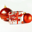 Red Christmas balls and a gift box — Stock Photo #8317114